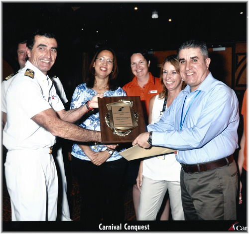 Carnival Cruise Lines awards the Tour Operation Department of La Romana Cruise Port. Captain Claudio Cupisti, the award plaque and La Romana Port Director Luis E. Rodriguez