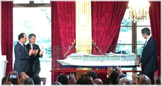 April 2016: Laurent Castaing (R), President of French shipyard STX France, Mediterranean Shipping Company (MSC) Chairman Gianluigi Aponte (C), and French President Francois Hollande (L) stand next to the model of the MSC Preziosa
