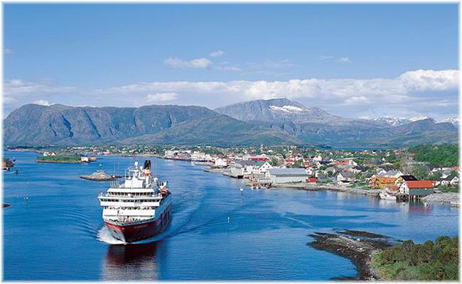 A Hurtigruten ship is leaving Bronnoysond, Norway (Brønnøysund)