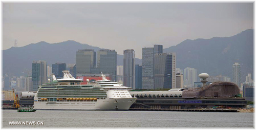 Hong Kong's Kai Tak Cruise Terminal and Royal Caribbean International's Mariner of the Seas (Photo credit News.cn - Chinanews.com)