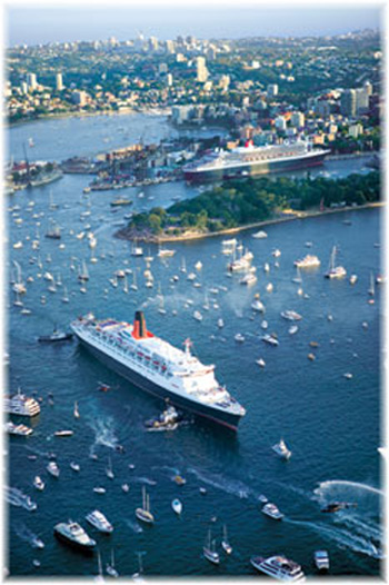 Historic Cunard Queens Rendezvous in Sydney Harbour, February 2007: The Queen Elizabeth 2 whistle saluted Queen Mary 2. The main visible difference is that now all the lifeboats have been removed