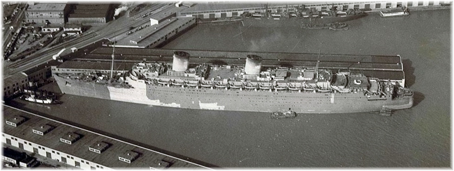 Queen Elizabeth at San Francisco Pier 35 on arrival from Esquimalt on 13 march 1942 (National Archives Photo of US) (Click to enlarge)