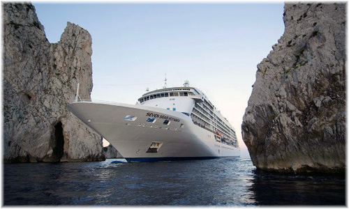 Seven Seas Voyager passing between two rocks at Capri