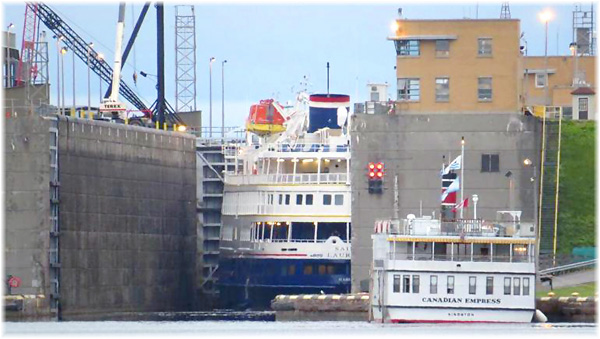 Two cruise ships at a Seaway lock is a rare occurrence, but this shot captures the 210-berth Saint Laurent in the lock and 64-berth Canadian Empress at the tie-up wall